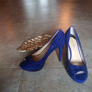 Black studded cobalt blue high heels